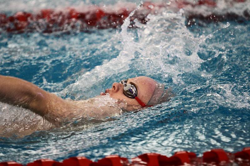 Noah Larschied swims backstroke at the WIAA Sectional Meet