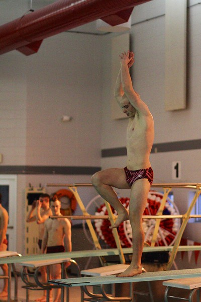 Tyler Stachura warming up at the WIAA Sectional Diving Meet at Neenah