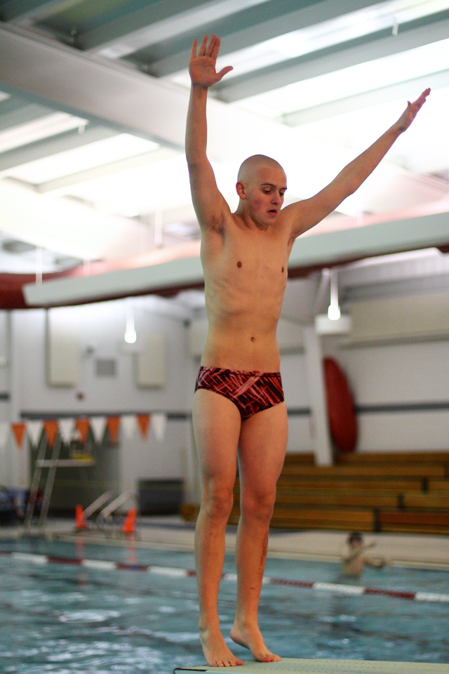 Jarrett Johnson warming up his back dive at the WIAA Sectional Meet