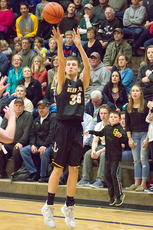 Record-Eagle/Brett A. Sommers Glen Lake's Reece Hazelton attempts a three-pointer during Friday's district championship game against Traverse City St. Francis. Glen Lake won 75-60.