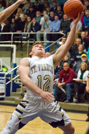 Record-Eagle/Brett A. Sommers Traverse City St. Francis' Gabe Callery attempts a layup during Friday's district championship game against Glen Lake. Glen Lake won 75-60.