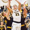 Record-Eagle/Brett A. Sommers Glen Lake's Cade Peterson drives to the rim past a pair of Iron Mountain defenders during Tuesday's Class C boys basketball quarterfinal at Petoskey High School. Glen Lake won 66-49.