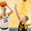 Record-Eagle/Brett A. Sommers Glen Lake's Cade Peterson (23) shoots over Iron Mountain's Charlie Gehrard (44) during Tuesday's Class C boys basketball quarterfinal at Petoskey High School. Glen Lake won 66-49.