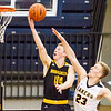 Record-Eagle/Brett A. Sommers Glen Lake's Cade Peterson (23) attempts to block the shot of Iron Mountain's Charlie Gehrard (44) during Tuesday's Class C boys basketball quarterfinal at Petoskey High School. Glen Lake won 66-49.