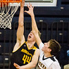 Record-Eagle/Brett A. Sommers Glen Lake's Reece Hazelton (35) attempts to block the shot of Iron Mountain's Charlie Gehrard (44) during Tuesday's Class C boys basketball quarterfinal at Petoskey High School. Glen Lake won 66-49.