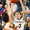 Record-Eagle/Brett A. Sommers Glen Lake's Xander Okerlund shoots over an Iron Mountain defender during Tuesday's Class C boys basketball quarterfinal at Petoskey High School. Glen Lake won 66-49.
