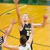 Record-Eagle/Brett A. Sommers Glen Lake's Cade Peterson wins the jump to begin Monday's Class C regional semifinal game against McBain at Houghton Lake High School. Glen Lake won 66-32.