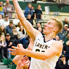 Record-Eagle/Brett A. Sommers Glen Lake's Cade Peterson shoots during Wendesday's regional championship boys basketball game against Whittemore Prescott at Houghton Lake High School. Glen Lake won 75-46.