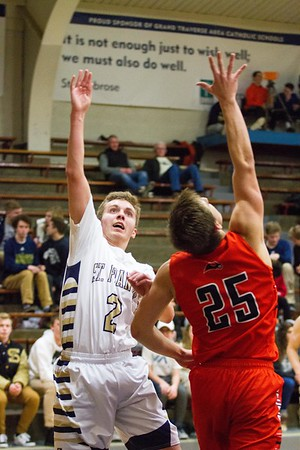 Record-Eagle/Brett A. Sommers Traverse City St. Francis' Mitch Lurvey (2) goes for the world's most epic high-five with Harbor Springs' Brett Vandermus (25) during the second half of Tuesday's boys basketball game at Traverse City St. Francis High School. St. Francis won 56-43.