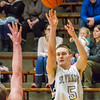Record-Eagle/Brett A. Sommers Traverse City St. Francis' Teddy Prichard shoots a 3-pointer during the first half of Tuesday's boys basketball game against Harbor Springs at Traverse City St. Francis High School. St. Francis won 56-43.