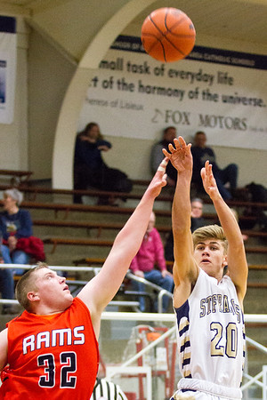 Record-Eagle/Brett A. Sommers Traverse City St. Francis' Keaton Peck (20) shoots over Harbor Springs' Chris Erxleben (32) during the second half of Tuesday's boys basketball game at Traverse City St. Francis High School. St. Francis won 56-43.