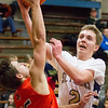 Record-Eagle/Brett A. Sommers Traverse City St. Francis' Mitch Lurvey (2) shoots over Harbor Springs' Brett Vandermus (25) during the second half of Tuesday's boys basketball game at Traverse City St. Francis High School. St. Francis won 56-43.