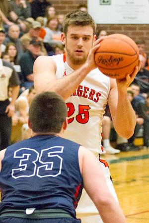 Record-Eagle/Brett A. Sommers Manton's Wyatt Baker breaks down Boyne City defender Jacob Ager during Wednesday's regional championship game in Houghton Lake. Manton won 47-46.