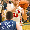 Record-Eagle/Brett A. Sommers Manton's Wyatt Baker breaks down Boyne City defender Jacob Ager during Wednesday's regional championship game in Houghton Lake. Manton won 47-46.