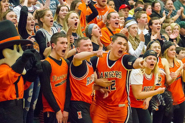 Record-Eagle/Brett A. Sommers Manton's student section celebrates during Wednesday's regional championship game against Boyne City in Houghton Lake. Manton won 47-46.