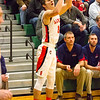 Record-Eagle/Brett A. Sommers Manton's Hunter Ruell attempts a three-pointer during Wednesday's regional championship game against Boyne City in Houghton Lake. Manton won 47-46.