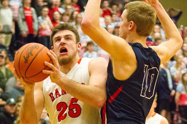 Record-Eagle/Brett A. Sommers Manton's Wyatt Baker attacks the basket against Boyne City defender Dylon Williams during Wednesday's regional championship game in Houghton Lake. Manton won 47-46.