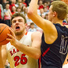 Record-Eagle/Brett A. Sommers Manton's Wyatt Baker attacks the basket against Boyne City defender Dylon Williams during Wednesday's regional championship game in Houghton Lake. Manton won 47-46.