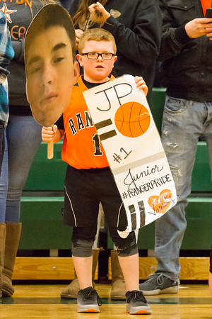 Record-Eagle/Brett A. Sommers Manton's A young Manton fan supports the Rangers' Jayden Perry during Wednesday's regional championship game against Boyne City in Houghton Lake. Manton won 47-46.