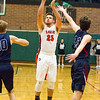 Record-Eagle/Brett A. Sommers Manton's Wyatt Baker attempts a three-pointer  during Wednesday's regional championship game against Boyne City in Houghton Lake. Manton won 47-46.