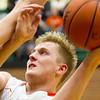 Record-Eagle/Brett A. Sommers Manton's Trever Salani shoots, while avoiding a defender, during Wednesday's regional championship game against Boyne City in Houghton Lake. Manton won 47-46.