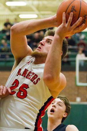 Record-Eagle/Brett A. Sommers Manton's Wyatt Baker leans back for a shot during Wednesday's regional championship game against Boyne City in Houghton Lake. Manton won 47-46.