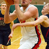 Record-Eagle/Brett A. Sommers Manton's Wyatt Baker absorbs contact during Wednesday's regional championship game against Boyne City in Houghton Lake. Manton won 47-46.
