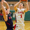 Record-Eagle/Brett A. Sommers Manton's Jayden Perry is fouled by Boyne City's Ethan Hewitt during Wednesday's regional championship game in Houghton Lake. Manton won 47-46.