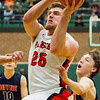Record-Eagle/Brett A. Sommers Manton's Wyatt Baker attempts a layup during Wednesday's regional championship game against Boyne City in Houghton Lake. Manton won 47-46.