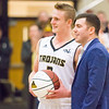 Record-Eagle/Brett A. Sommers Traverse City Central's Tobin Schwannecke (left) and coach Travis Schuba celebrate Schwannecke's 1,000th career point during Saturday's game against Traverse City West. Central won 48-33.