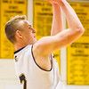 Record-Eagle/Brett A. Sommers Traverse City Central's Tobin Schwannecke makes converts a jump shot, scoring the 1,000th point of his prep career, during Saturday's game against Traverse City West. Central won 48-33.