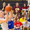 Record-Eagle/Brett A. Sommers Traverse City Central's Tobin Schwannecke drives to the basket during Saturday's game against Traverse City West. Central won 48-33.