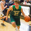 Record-Eagle/Brett A. Sommers Traverse City West's Patrick O'Connor (34) dribbles by Traverse City Central's Tobin Schwannecke during Saturday's game. Central won 48-33.