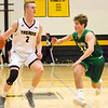 Record-Eagle/Brett A. Sommers Traverse City Central's Tobin Schwannecke dribbles the ball at Traverse City West's Patrick O'Connor during Saturday's game. Central won 48-33.
