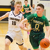 Record-Eagle/Brett A. Sommers Traverse City West's Andy Soma drives the ball against Traverse City Central's Sam Schmitt during Saturday's game. Central won 48-33.