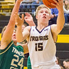 Record-Eagle/Brett A. Sommers Traverse City Central's Sam Schmitt convers a layup during Saturday's game against Traverse City West. Central won 48-33.
