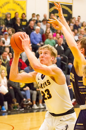 Record-Eagle/Brett A. Sommers Glen Lake's Cade Peterson drives to the basket during Friday's boys basketball district championship against Traverse City St. Francis. Glen Lake won 61-33.