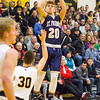 Record-Eagle/Brett A. Sommers Traverse City St. Francis' Keaton Peck launches a 3-pointer during the first half of Friday's district championship game. Glen Lake won 61-33.