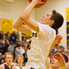 Record-Eagle/Brett A. Sommers Glen Lake's Xander Okerlund shoots during the second half of Friday's district championship game against Traverse City St. Francis. Glen Lake won 61-33.