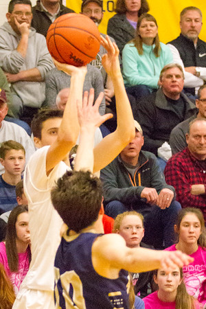 Record-Eagle/Brett A. Sommers Glen Lake's Xander Okerlund makes a 3-pointer to open the second half of Friday's district championship game against Traverse City St. Francis. Glen Lake won 61-33.