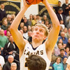 Record-Eagle/Brett A. Sommers Glen Lake's Cade Peterson shoots during the second half of Friday's district championship game against Traverse City St. Francis. Glen Lake won 61-33.