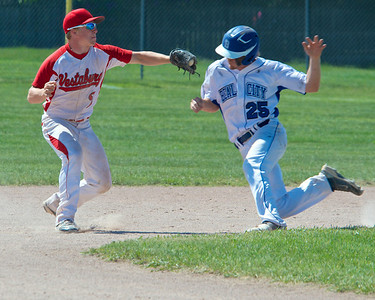 Skip Traynor - Special to the Sun Vestaburg's Jarred Stratton goes for the tag on Beal City's Salisbury Carson during the final game of the Division 4 District 110 playoffs at Breckenridge Saturday, May 31, 2014. Beal City won the game 11-1 in 5 innings.