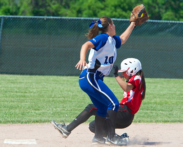 Skip Traynor - Special to the Sun Vestaburg's Shana Fisk slides under a tag by Beal City's Jenna Theisen during the final game against Beal City of the Division 4 District 110 playoffs at Breckenridge Saturday, May 31, 2014. Vestaburg took the district crown with a 13-3 win.