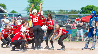 Skip Traynor - Special to the Sun Vestaburg players celebrate a home run by Janelle Rons during the final game against Beal City in the Division 4 District 110 playoffs at Breckenridge Saturday, May 31, 2014. Vestaburg took the district crown with a 13-3 win.