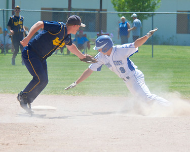 Skip Traynor - Special to the Sun Breckenridge shortstop D Moulton goes for the tag on Beal City's Tucker Gross during the final game of the Division 4 District 110 playoffs at Breckenridge Saturday, May 31, 2014. Beal City won the district crown with wins over Breckenridge and Vestaburg.