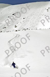 One of my all-time favorite shots (Todd on Peak 7). We had just the three sets of tracks on the right up top and it was fantastic with the great steep pitch of Art's Bowl and powder. These are bonus turns on a small face down below. This won second place in The Great Divide Guide photo contest.