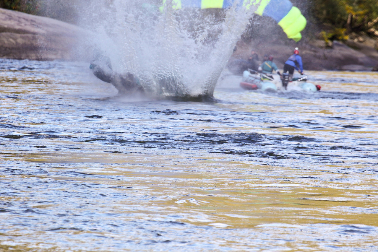 """Christopher Brewer jump at Bridge Day 2011.  Photo 5 of 9.  To everyone's horror his chute did not open all the way.  It is estimated he struck the water at between 60 and 80 mph.  Four days following the incident he is in critcal, but stable condition.  32nd Annual Bridge Day Celebration, Fayetteville, West Virginia, October 15, 2011.  Hover mouse over photo and click """"X3"""" to enlarge photo's."""