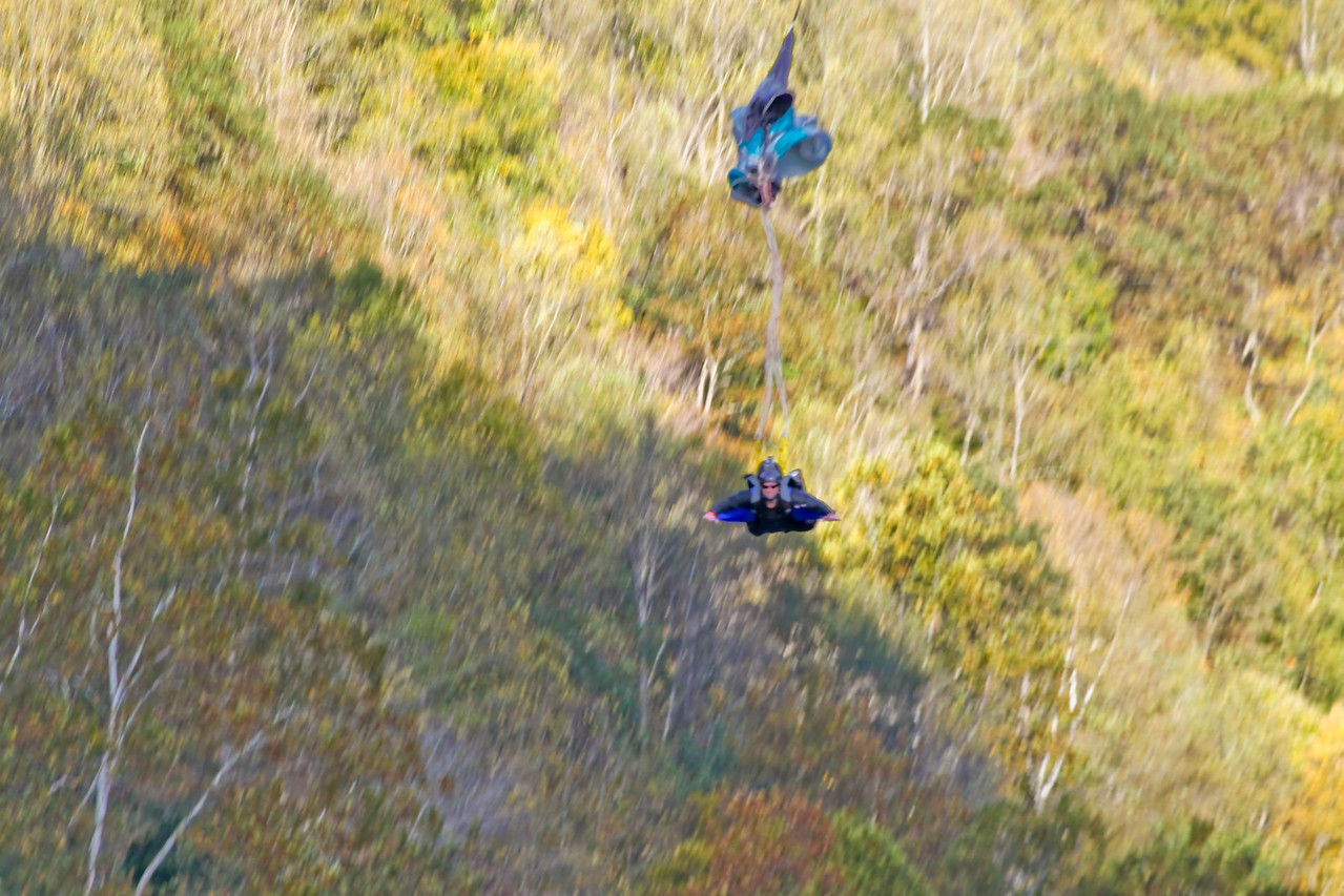 "Christopher Brewer jump at Bridge Day 2011.  Photo 4 of 9.  About 40 meters above the river!  To everyone's horror his chute did not open all the way.  It is estimated he struck the water at between 60 and 80 mph.  Four days following the incident he is in critcal, but stable condition.  32nd Annual Bridge Day Celebration, Fayetteville, West Virginia, October 15, 2011.  Hover mouse over photo and click ""X3"" to enlarge photo's."