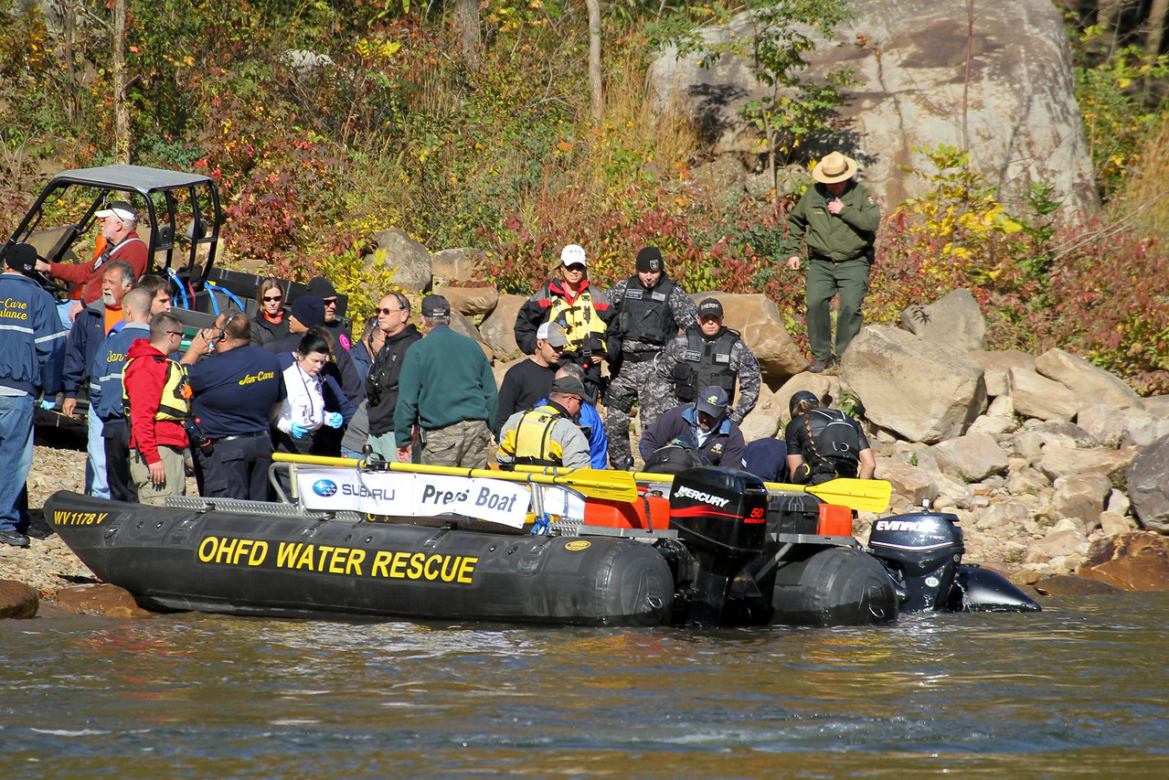 "Christopher Brewer jump at Bridge Day 2011.  Photo 9 of 9.  To everyone's horror his chute did not open all the way.  It is estimated he struck the water at between 60 and 80 mph.  Four days following the incident he is in critcal, but stable condition.  32nd Annual Bridge Day Celebration, Fayetteville, West Virginia, October 15, 2011.  Hover mouse over photo and click ""X3"" to enlarge photo's."