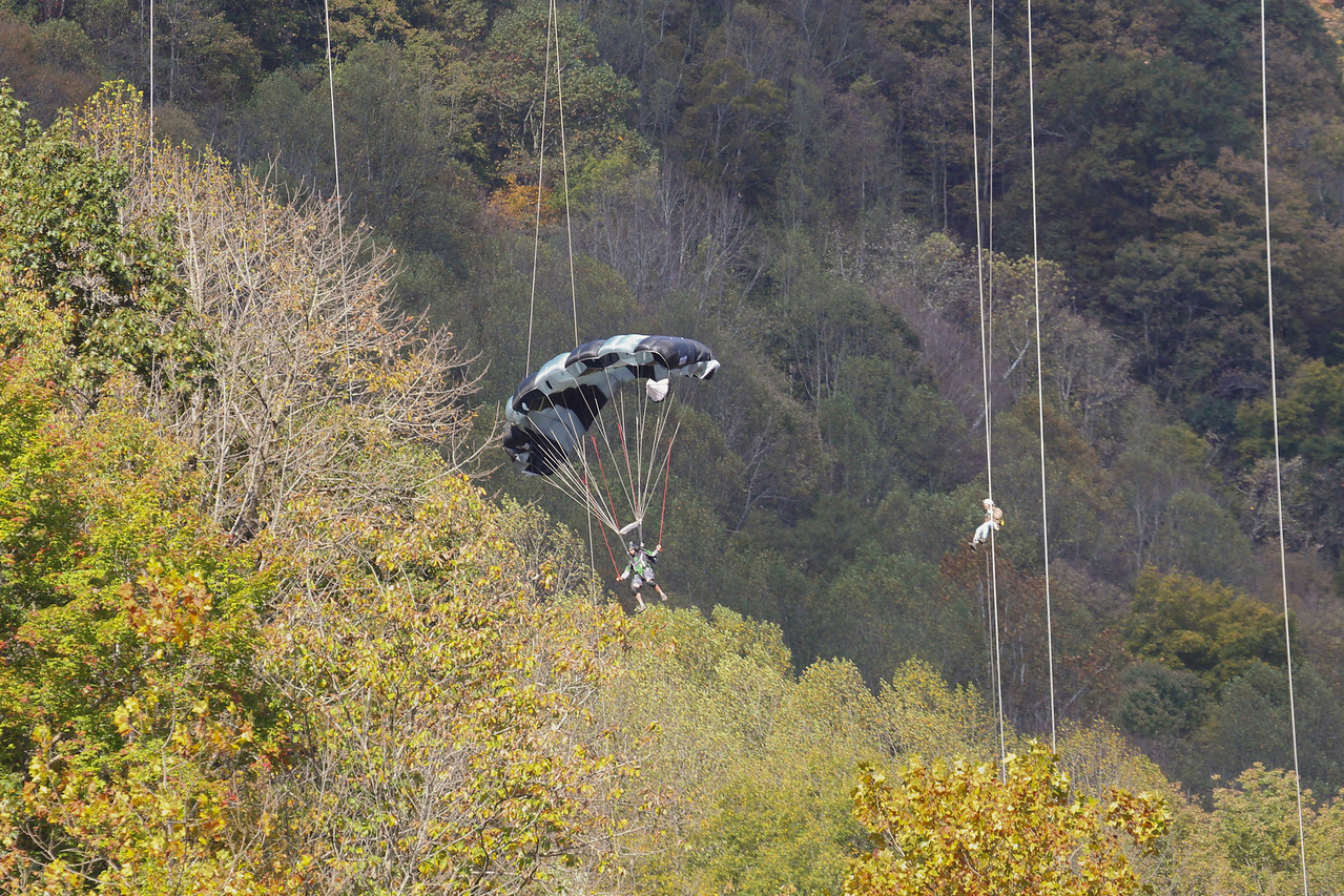"32nd Annual Bridge Day Celebration, Fayetteville, West Virginia, October 15, 2011.  Hover mouse over photo and click ""X3"" to enlarge photo's.  This jumper went way off course and landed in the treetops."